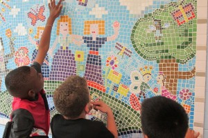 13_pointing_out_their_artistic_contributin_to_mural