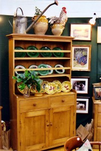 china-cabinet-with-green-plates-and-rooster-on-top