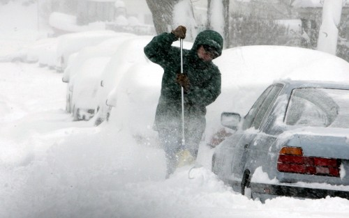 Conor Lyons attempts to free his car from the snow outside his home in Irvington Feb. 9, 2006 during the year's first major snow storm.   Seth Harrison/The Journal News