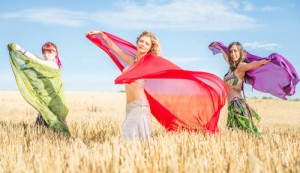 Belly dancer group in action . Belly dancer gilrs performing in a wheat field. concept about fashion and discipline