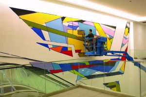 city-center_piero-manrique-working-on-city-center-mural-with-airbrush