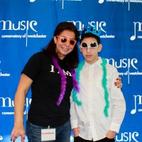 Parent and teen student volunteers Josephine Marjieh and Ramez Marjieh posed for the photo booth at the Music Conservatory of Westchester's Performathon fundraiser.