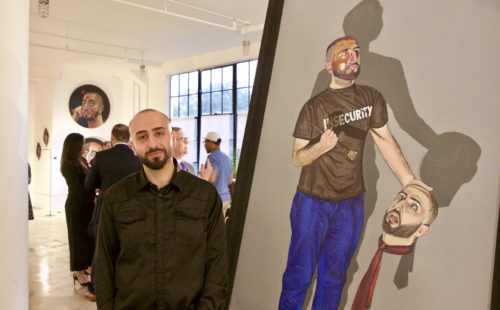 Artist Samer Akroush with one of his pieces.