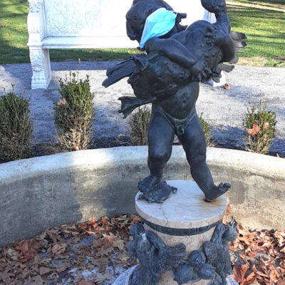 Frederick William MacMonnies 'Boy with Duck' fountain piece, wearing face protection (photo courtesy of Lyndhurst)