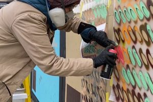 Artist Jana Liptak as she worked on her mural in downtown White Plains