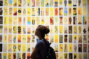 A visitor observing Manju Shandler's GESTURE installation
